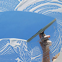 Squeegee cleaning window
